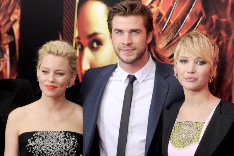 Elizabeth Banks, Liam Hemsworth and Jennifer Lawrence. UPI/Dennis Van Tine