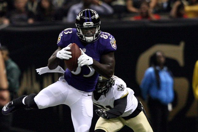 Baltimore Ravens wide receiver Deonte Thompson (83) takes a pass for 11 yards before New Orleans Saints cornerback Patrick Robinson (21). UPI/A.J. Sisco