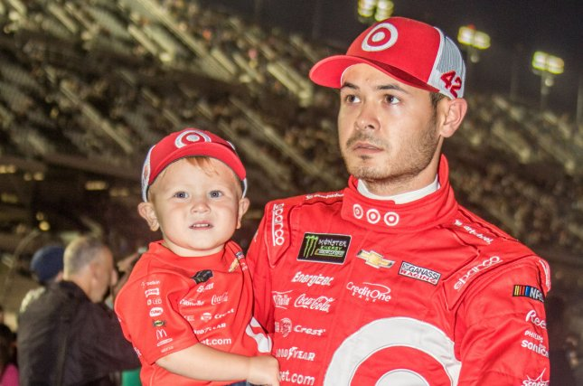 Kyle Larson carries his son Owen across the stage after being introduced prior to the start of the 2017 Can-Am Duels at Daytona on February 23, 2017 in Daytona, Florida. File photo by Edwin Locke/UPI