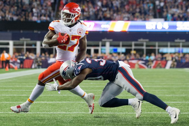 Kansas City Chiefs running back Kareem Hunt charges past New England Patriots defensive back Duron Harmon for a four-yard touchdown in the NFL season-opener Thursday. Photo by Matthew Healey/ UPI