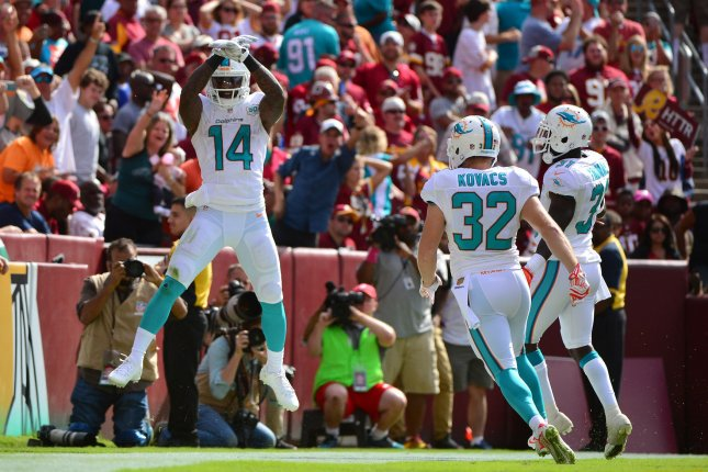 Miami Dolphins receiver Jarvis Landry celebrates after returning a punt for a 69-yard touchdown against the Washington Redskins in the fourth quarter at FedEx Field in Landover, Maryland on September 13, 2015. File photo by Kevin Dietsch/UPI
