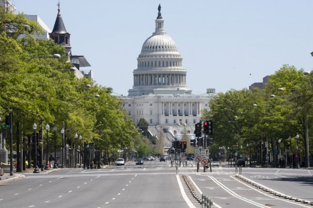 Pennsylvania Avenue that runs between the White House and the U.S. Capitol is virtually empty of traffic on April 22, in Washington, D.C. Two measures passed by Congress to help Americans facing hardship are set to expire Friday, unless they're extended by lawmakers. File Photo by Pat Benic/UPI