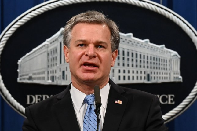 FBI Director Christopher Wray speaks during a press conference on a national security matter at the Department of Justice in Washington, D.C., on October 7. The FBI said Thursday that Russia compromised two local or state  government networks. Pool Photo by Jim Watson/UPI
