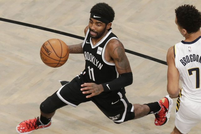 Kyrie Irving and the Brooklyn Nets host the Golden State Warriors in the first game of the regular season at 7 p.m. EST Tuesday at Barclays Center in Brooklyn, N.Y. File Photo by John Angelillo/UPI