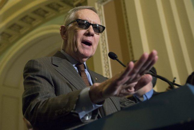 Senate Minority Leader Harry Reid has been wearing protective glasses since he injured his eye earlier this year. File Photo by Kevin Dietsch/UPI