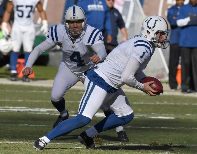 Indianapolis Colts holder Pat McAfee (1) takes off on a fake field goal as kicker Adam Vinatieri (4) looks on against the Oakland Raiders at the Oakland Coliseum. File Photo by Terry Schmitt/UPI