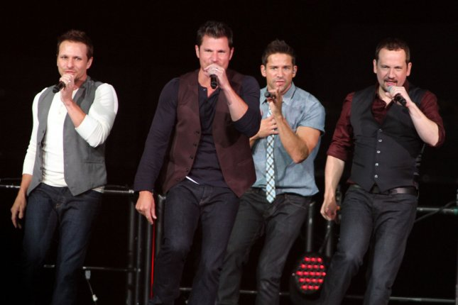 98 degrees performs in concert at the bb t center in sunrise florida on june 22 2013 the band is working on a new christmas album - 98 Degrees Christmas