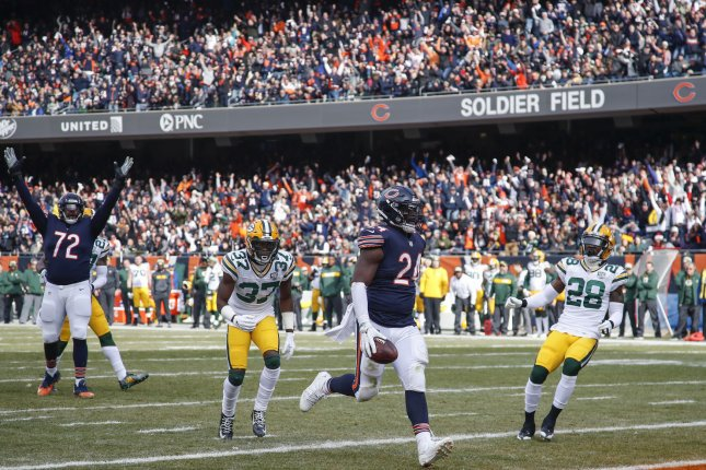 Chicago Bears running back Jordan Howard (24) scores a touchdown against the Green Bay Packers as Charles Leno Jr. (left) celebrates during the first half on Sunday at Soldier Field in Chicago. Photo by Kamil Krzaczynski/UPI