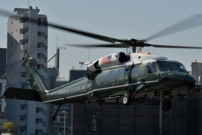 President Donald Trump flies aboard Marine One -- a VH-60N White Hawk -- from the Akasaka Press Center on May 26. File Photo by Keizo Mori/UPI