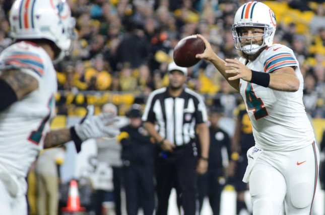 Miami Dolphins quarterback Ryan Fitzpatrick (14) threw all three of his touchdown passes in the first half during a win against the New York Jets Sunday in Miami. Photo by Archie Carpenter/UPI