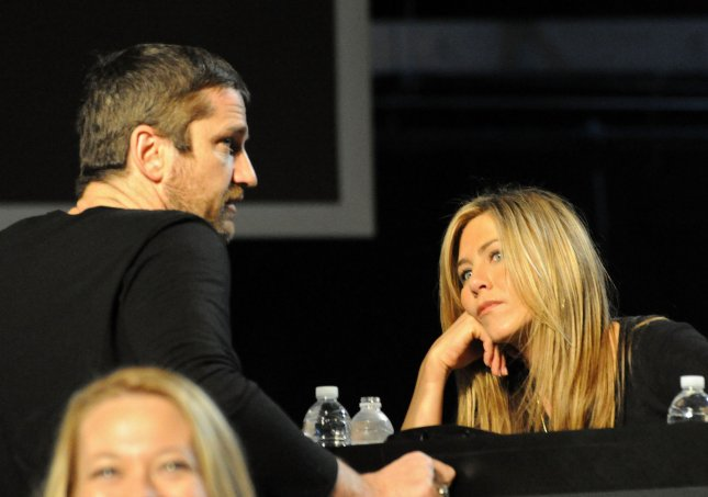 In this handout photo provided by MTV, actor Gerard Butler (L) and actress Jennifer Aniston participate in the Hope For Haiti Now: A Global Benefit For Earthquake Relief telethon on January 22, 2010 in Los Angeles. UPI/Jeff Kravitz/HO