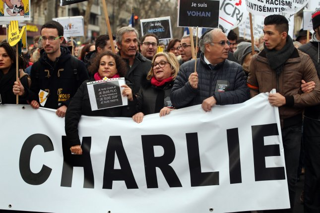 More than 3 million people, including prime ministers Angela Merkel of Germany and David Cameron of Britain, marched Sunday in Paris in a show of solidarity after last week's deadly attacks. Rep. Randy Weber, R-Texas. compared President Obama unfavorably to Hitler in a tweet criticizing him for not joining the march. Photo by Eco Clement/UPI