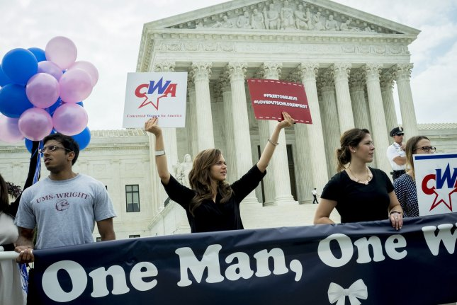 Same sex marriage opponents camp out early in front of the United States Supreme Court in Washington, D.C., on June 26, 2015, to await the Court's ruling on the ability of same sex couples to marry. The 5-4 ruling in favor was announced that legalizes the ability for same-sex couples to marry nationwide. Photo by Pete Marovich/UPI