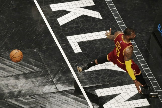 Cleveland Cavaliers' LeBron James lands on the court after dunking the basketball in the first quarter against the Brooklyn Nets at Barclays Center in New York City on January 20, 2016. The Cavaliers defeated the Nets 91-78. Photo by John Angelillo/UPI