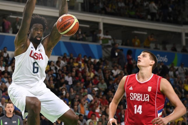American forward DeAndre Jordan (R) stuffs the ball over Serbian defender Nikola Jokic during the USA-Serbia Men's Preliminary Basketball game at the 2016 Rio Summer Olympics in Rio de Janeiro, Brazil, August 12, 2016. The The U.S. team won a close game, 94-91. Photo by Mike Theiler/UPI