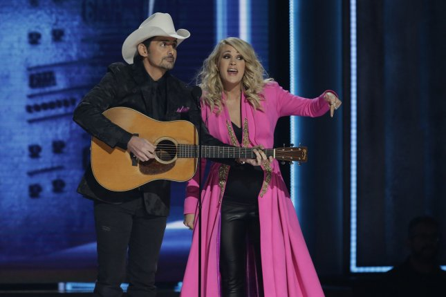 Brad Paisley (L) and Carrie Underwood perform during the 52nd Annual Country Music Association Awards on Wednesday in Nashville. Photo by John Angelillo/UPI