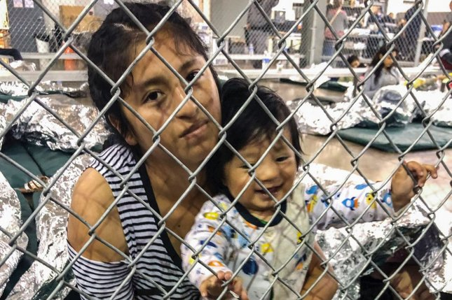 Women and children lie on th floor behind cyclone fencing at the Central Processing Center in McAllen, Texas, on Saturday. Vice President Mike Pence toured the area the day before. Photo courtesy of Rep. Doris Matsui's office