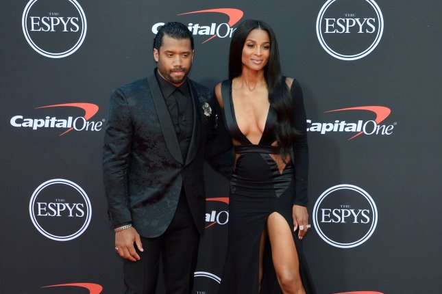 Seattle Seahawks quarterback Russell Wilson (L) and his wife, Ciara, are among 11 families to join the Seattle Sounders' ownership group. File Photo by Jim Ruymen/UPI