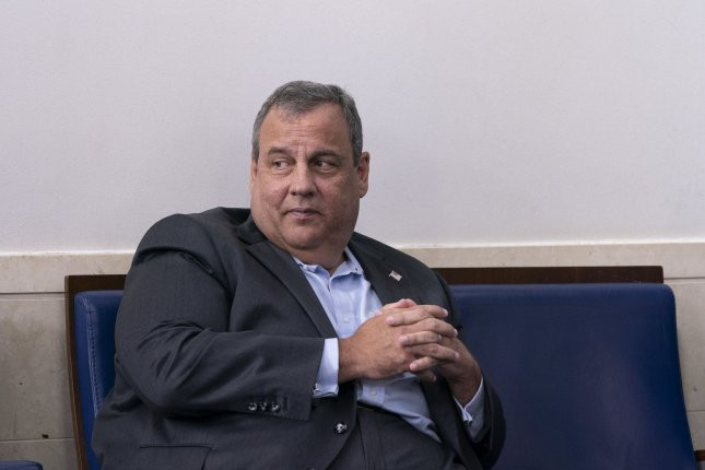 Former New Jersey Gov. Chris Christie listens as President Donald Trump holds a news briefing at the White House on September 27 in Washington, D.C. He tested positive for coronavirus less than one week later. Pool photo by Chris Kleponis/UPI