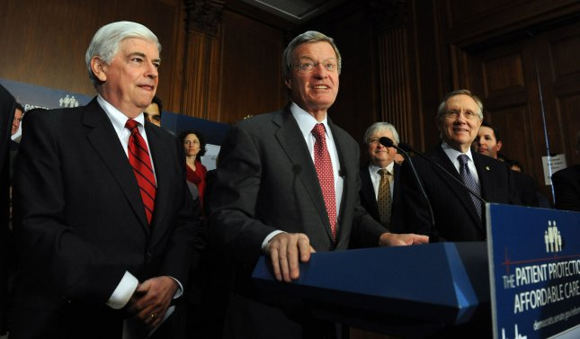 Sen. Christopher Dodd, D-CT, Sen. Max Baucus, D-MT, and Senate Majority Leader Harry Reid, D-NV, (L to R) participate in a rally after a series of votes on the health care reform bill on Capitol Hill in Washington on December 22, 2009. The Senate voted 60-39 on strict party lines to move the bill forward. UPI/Roger L. Wollenberg