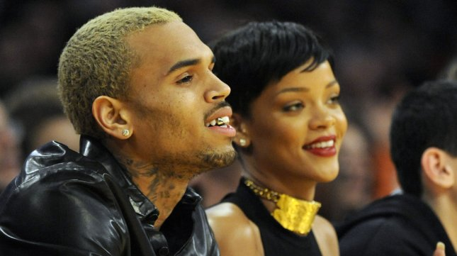 Chris Brown and Rihanna watch the Los Angeles Lakers play the New York Knicks in an NBA basketball game in Los Angeles on December 25, 2012. UPI/Lori Shepler