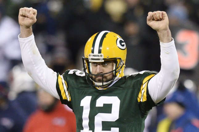Green Bay Packers quarterback Aaron Rodgers celebrates after the Packers got a first down to ice the game during the fourth quarter against the New England Patriots at Lambeau Field on November 30, 2014 in Green Bay, Wisconsin. The Packers defeated the Patriots 26-21. UPI/Brian Kersey