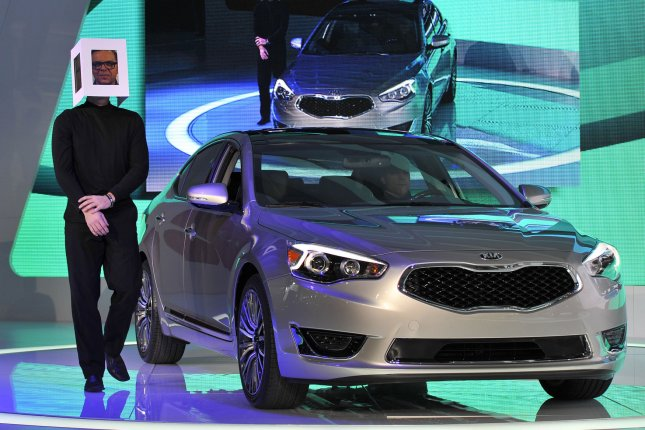 An actor wearing an iPad mask portraying the likeness of Peter Schreyer, president of design for Hyundai and Kia, introduces the 2014 Cadenza at the 2013 North American International Auto Show in Detroit on January 15, 2013. UPI/Brian Kersey