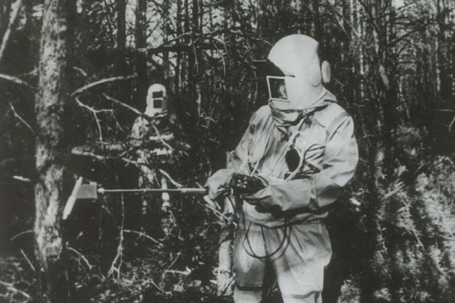 Unidentified workers take radiation measurements in the area surrounding the Chernobyl Nuclear Power Plant in Ukraine, following the April 26, 1986, explosion. UPI/INS