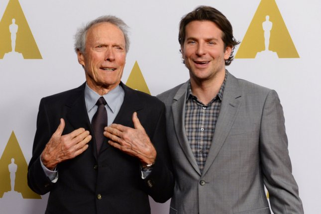 American Sniper director Clint Eastwood (L) and the film's star Bradley Cooper attend the 87th annual Academy Awards Oscar nominees luncheon at the Beverly Hilton Hotel in Beverly Hills, Calif. on Feb. 2, 2015. Photo by Jim Ruymen/UPI