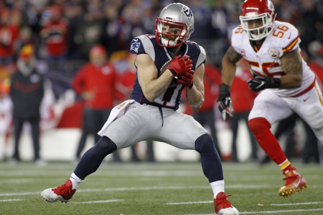 New England Patriots wide receiver Julian Edelman (11) pulls in a six-yard reception while chased down by Kansas City Chiefs linebacker Derrick Johnson in the fourth quarter of the AFC Divisional Playoff at Gillette Stadium in Foxborough, Massachusetts on January 16, 2016. The Patriots defeated 27-20. Photo by Matthew Healey/UPI