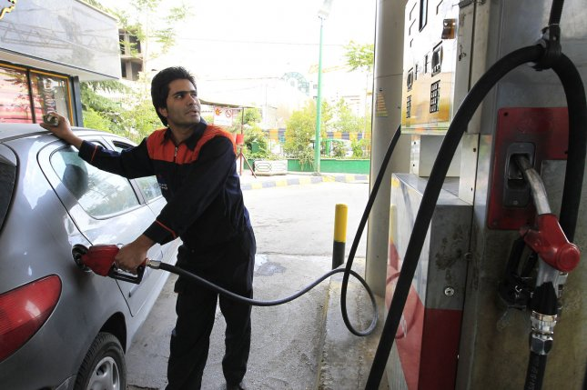 An Iranian man pumps gasoline into his car at a station in Tehran, Iran. File Photo by Maryam Rahmanian/UPI