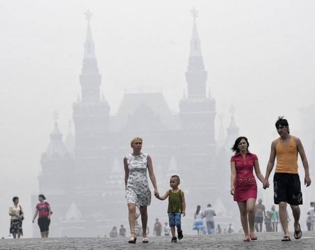St. Basil's Cathedral is seen through a heavy smog on Red Square in Moscow on August 4, 2010. The Russian capital was blanketed in thick smoke after several days of nearby forest and peat fires. UPI/Alex Volgin