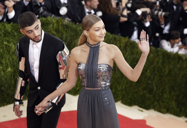 Gigi Hadid (R) and Zayn Malik arrive on the red carpet at the Costume Institute Benefit at The Metropolitan Museum of Art celebrating the opening of Manus x Machina: Fashion in an Age of Technology in New York City on May 2, 2016. Hadid was recenly assaulted outside the Max Mara fashion show in Milan. File Photo by John Angelillo/UPI