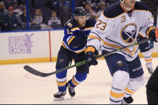 St. Louis Blues Jaden Schwartz tries to make it to the bench with an apparent leg injury after getting tied up with Buffalo Sabres goaltender Robin Lehner in the first period at the Scottrade Center in St. Louis on November 15, 2016. Photo by Bill Greenblatt/UPI