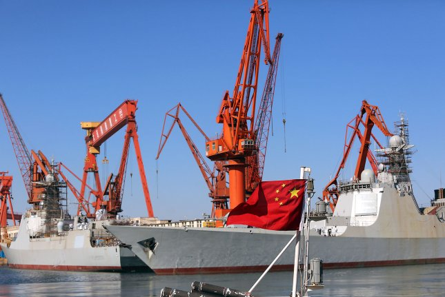 Docked Chinese warships undergo maintenance in the port city of Dalian, China. China has not stopped expanding its presence in disputed areas of the South China Sea. Photo by Stephen Shaver/UPI