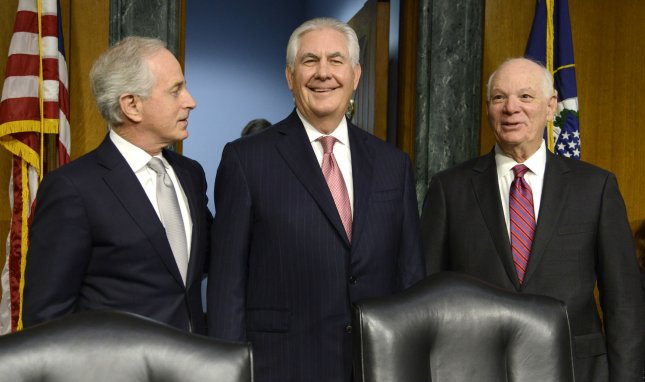 Secretary of State Rex Tillerson (C), stands with Sens. Bob Corker, R-Tenn., (L) and Ben Cardin, D-Md., (R). Corker authored legislation to toughen diplomatic sanctions against Russia and Iran. Fle Photo by Mike Theiler/UPI