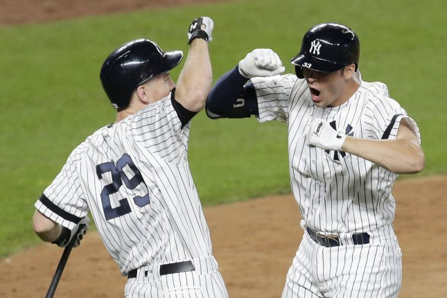 New York Yankees' Greg Bird celebrates with Todd Frazier after he hits a solo home run in the 7th inning against the Cleveland Indians in Game 3 in the 2017 MLB Playoffs American League Divisional Series Sunday at Yankee Stadium in New York City. Photo by John Angelillo/UPI