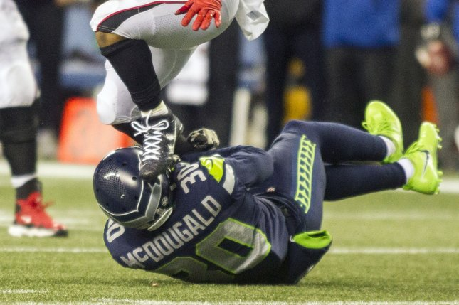 Atlanta Falcons running back Terron Ward (28) escapes from Seattle Seahawks defensive back Bradley McDougald (30) and rushes for a 17-yard gain against the Seattle Seahawks during the fourth quarter at CenturyLink Field in Seattle, Washington on November 20, 2017. File photo by Jim Bryant/UPI
