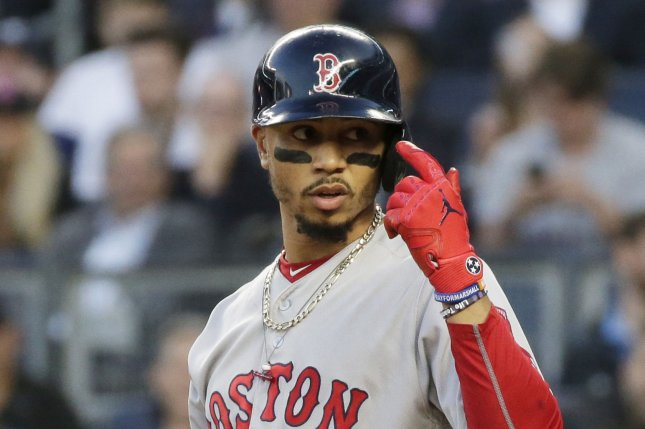 a47a41f61 Boston Red Sox outfielder Mookie Betts reacts after almost being hit by a  pitch in the 2nd inning against the New York Yankees on May 9 at Yankee  Stadium in ...