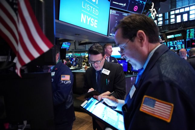 Traders work on the floor of the New York Stock Exchange on Wall Street in New York City on Monday. Photo by John Angelillo/UPI