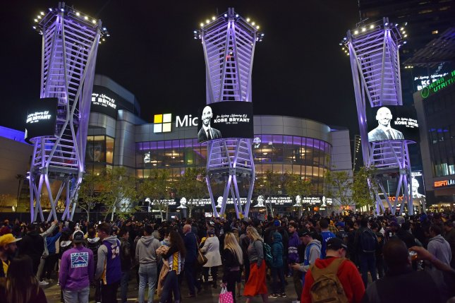 Los Angeles Lakers fans gather in a plaza at LA LIVE near the Staples Center in Los Angeles to mourn the loss of NBA legend Kobe Bryant. Bryant, his daughter Gianna, 13, and seven other people were killed in a helicopter crash Sunday in Calabasas, Calif. Photo by Chris Chew/UPI
