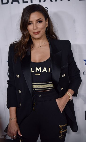 Eva Longoria arrives for the Puma x Balmain x Cara Delevingne launch party at Milk Studios in Los Angeles on November 21. She turns 45 on March 15. File Photo by Chris Chew/UPI