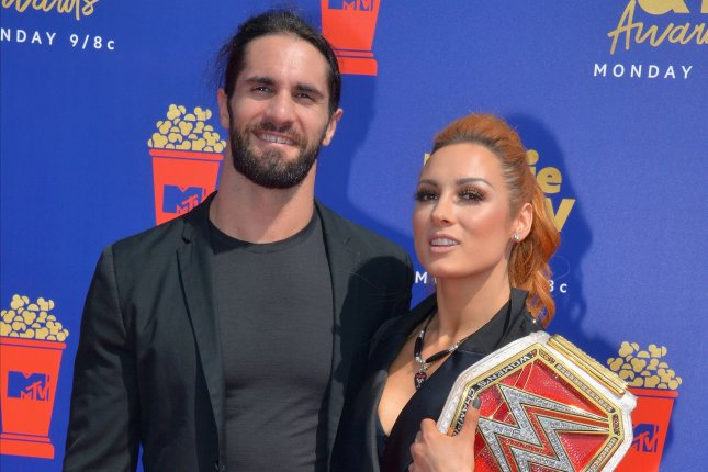 Becky Lynch (R), pictured with Seth Rollins, will guest star in Billions Season 5, which premieres Sunday on Showtime.  File Photo by Jim Ruymen/UPI