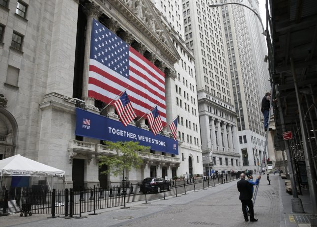 A giant American Flag and a sign that reads Together, We're Strong hangs outside of the New York Stock Exchange on Wall Street in New York City on Thursday, May 28, 2020. Photo by John Angelillo/UPI