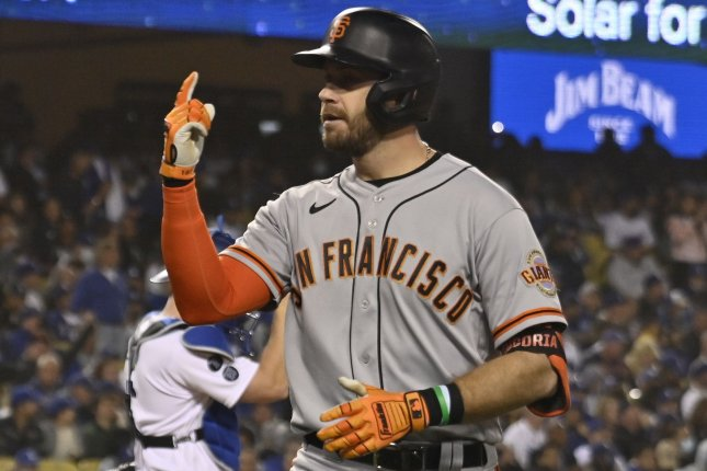 San Francisco Giants third baseman Evan Longoria gestures after hitting a solo home run during the fifth inning off Los Angeles Dodgers' starting pitcher Max Scherzer in Game 3 of the NLDS on Monday at Dodger Stadium in Los Angeles. Photo by Jim Ruymen/UPI