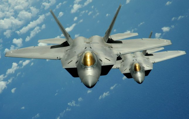 Two F-22 Raptor aircrafts fly over the Pacific Ocean during a security mission on March 9, 2009. The Raptors are deployed for three months to the 90th Expeditionary Fighter Squadron on Andersen Air Force Base, Guam, as part of the Pacific's Theater Security Package. (UPI Photo/Kevin J. Gruenwald/U.S. Air Force)
