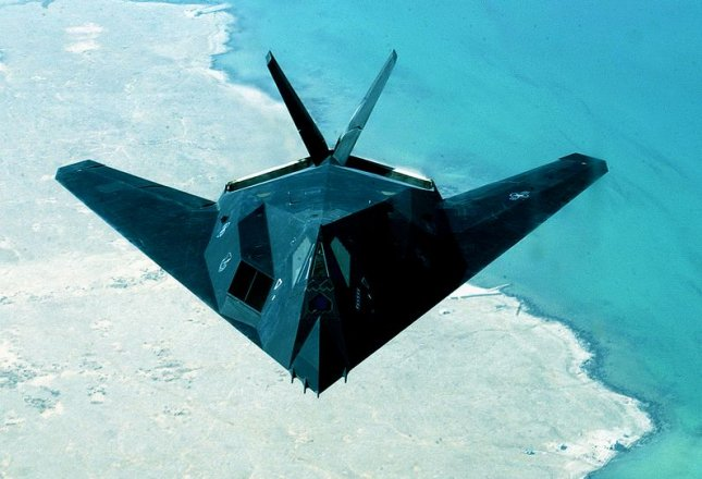 AFIE2003041503 - FORWARD DEPLOYED, April 12 (UPI) -- An F-117 from the 8th Expeditionary Fighter Squadron out of Holloman A.F.B., NM, flies over the Persian Gulf on April 14, 2003. The 8th EFS has begun returning to Hollomann A.F.B. after having been deployed to the Middle East in support of Operation Iraqi Freedom. rlw/U.S. Air Force photo/Derrick C. Goode UPI..