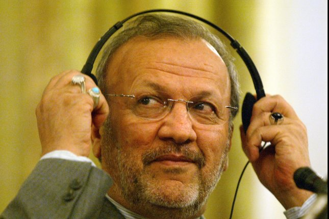 Iran's Foreign Minister Manouchehr Mottaki adjusts his headphones during a press conference with his Omani counterpart Yousef ben Alavi (not shown) in Tehran, Iran on July 17, 2007. (UPI Photo/Mohammad Kheirkhah)
