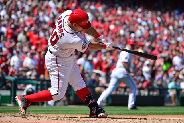 Washington Nationals catcher Wilson Ramos hits a grand slam in the fourth inning against the New York Mets at Nationals Park in Washington, D.C. on September 7, 2015. Photo by Kevin Dietsch/UPI