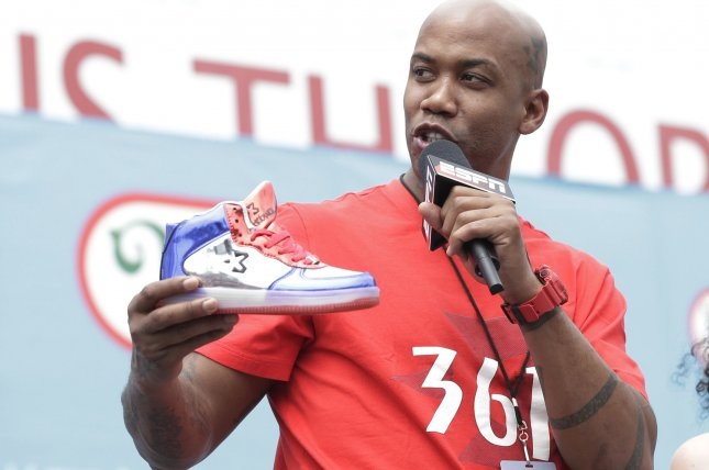 Stephon Marbury holds a Starbury sneaker before the Nathan's Famous Fourth of July International Hot Dog Eating Contest 101st anniversary on July 4 in Coney Island. File photo by John Angelillo/UPI